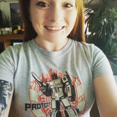 Geek Fuel unboxer with a Transformers shirt