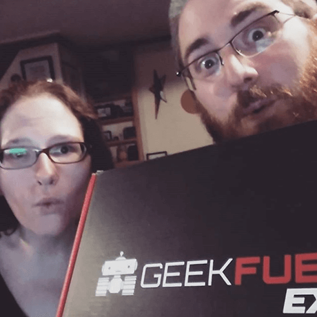 Two unboxers holding a Geek Fuel EXP box