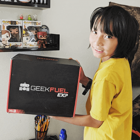 Little kid with Geek Fuel EXP box